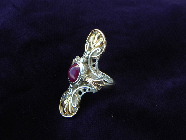 One-of-a-Kind silverring with a blossom of ruby and gold