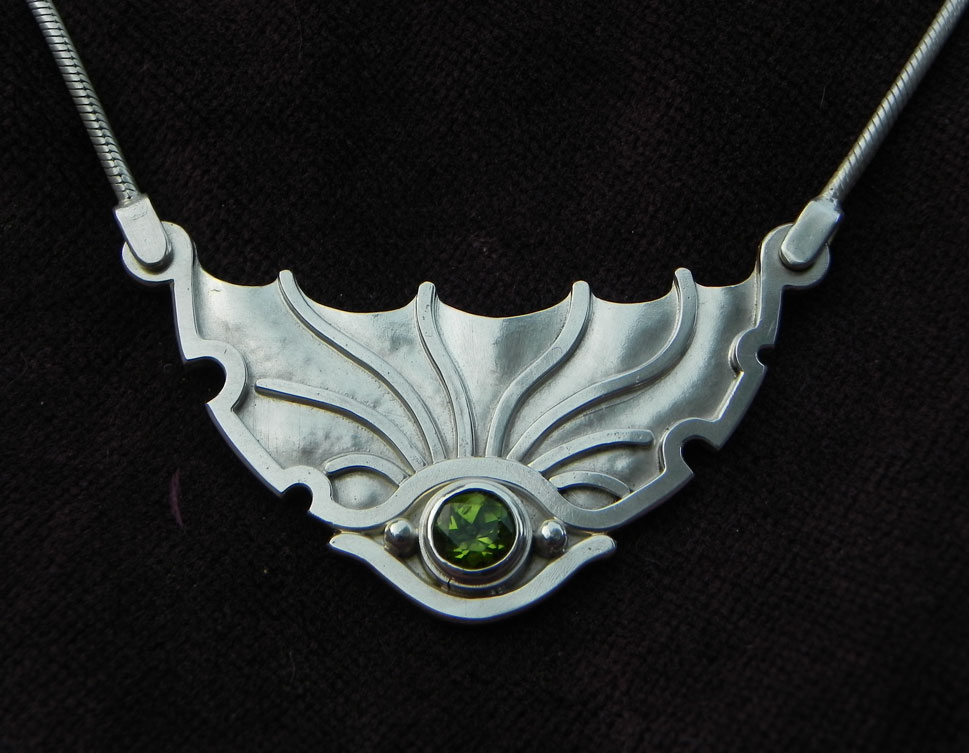 Silverpendant shaped as an eye of a Dragon