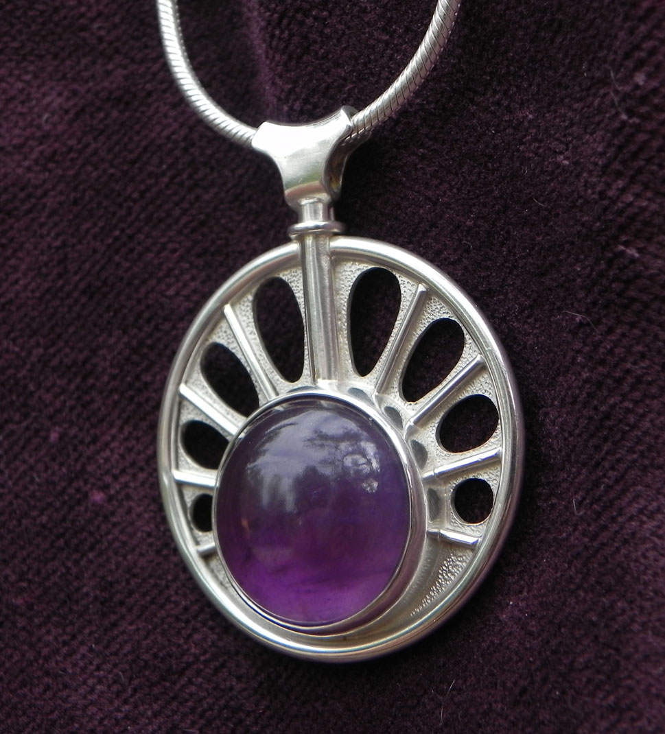 pendant with a big amethyst in a sun shape 2. view