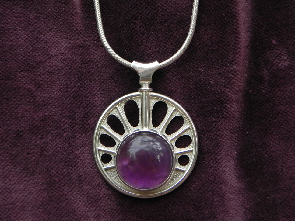 pendant with a big amethyst in a sun shape