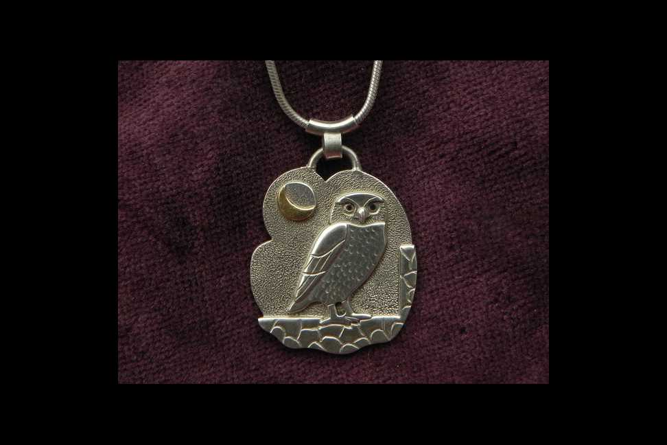 owl on silver pendant