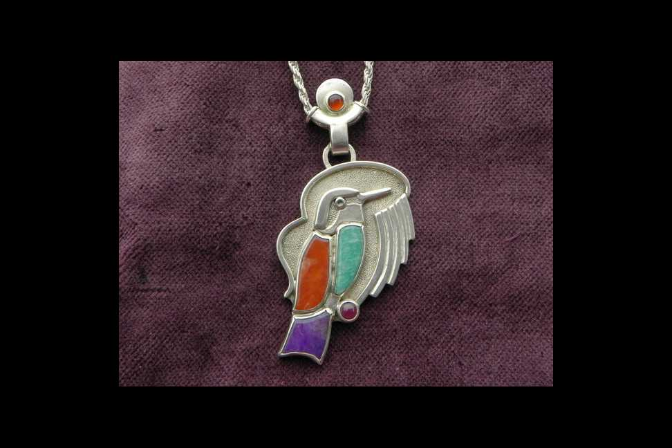 bird with gemstones on silver