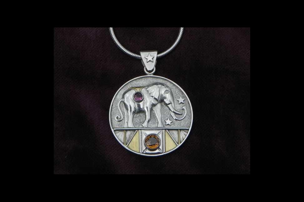 silver pendant with elephant