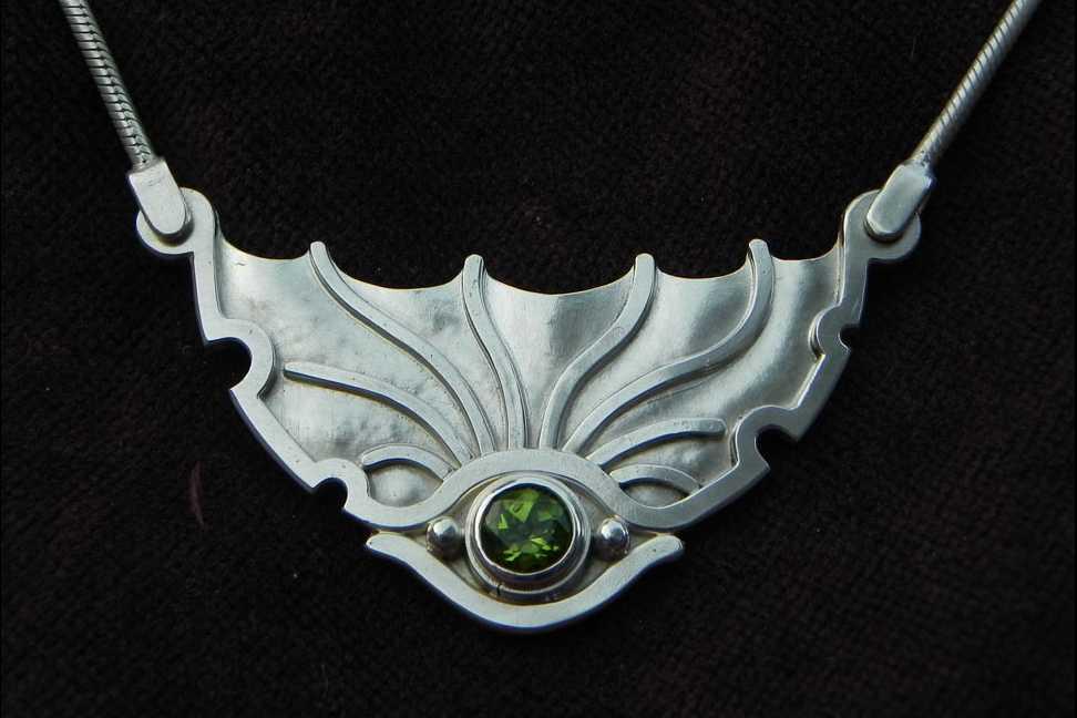 Silverpendant shaped as an eye of a Dragon
