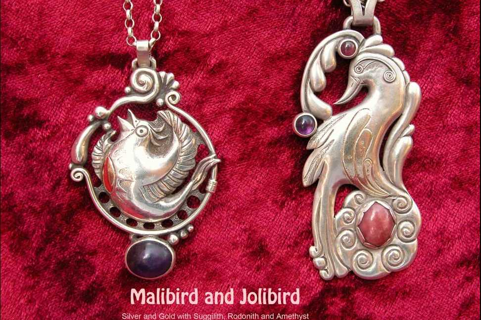 2 Silverpendants with birds and Gemstones