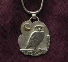 owl on silver pendant
