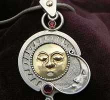Sun and moon on a silverpendant